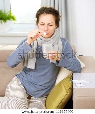 Ill Woman Taking Aspirin Pills.Headache. Pain.Sick Woman.Flu.Woman Caught Cold. Sneezing into Tissue. Headache. Virus .Medicines - stock photo