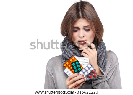 ill woman taking her temperature wile feeling sick and with fever, isolated on a white background - stock photo