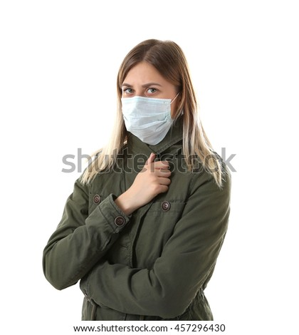 Ill woman wearing mask isolated on white - stock photo