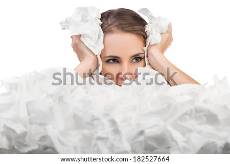 Ill woman with a lot of hankys. Isolated on white background - stock photo