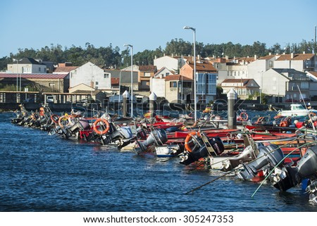 ILLA DE AROUSA, SPAIN - NOVEMBER 30, 2014: Detail of fishing boats anchored in the harbor of this beautiful island in the Ria de Arousa in Galicia.