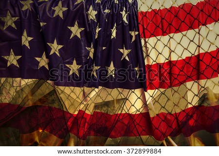 Illegal immigration concept Background of transparent American flag behind a chain link fence and broken glass in the window - stock photo