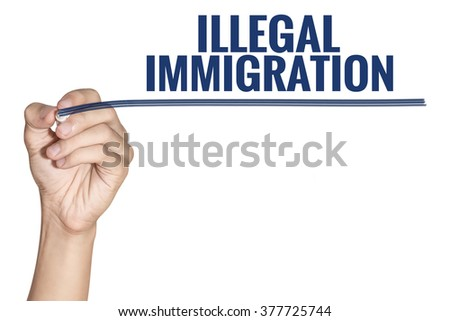 Illegal Immigration word write by man hand hold a pen on white background - stock photo