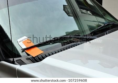 Illegal Parking Violation Citation On Car Windshield - stock photo