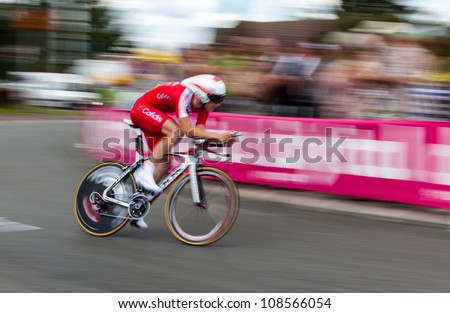 "ILLIERS-COMBRAY,FRANCE,JUL 21:Panning image of a cyclist from Cofidis team riding during the 19th stage- a time trial  between Bonneval and Chartres- of ""Le Tour de France"" on July 21 2012. - stock photo"