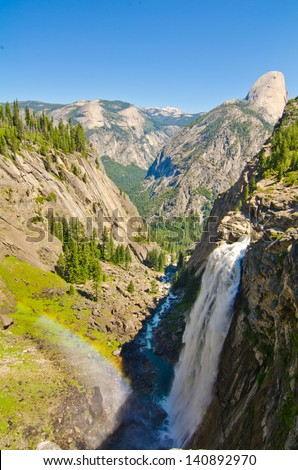 Illilouette Falls with Liberty Cap visible in the background at Yosemite National Park. - stock photo