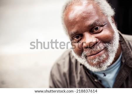 ILLINOIS, USA - AUGUST 9, 2013: Portrait of elderly black man in Chicago on August 9, 2013, Illinois, USA - stock photo