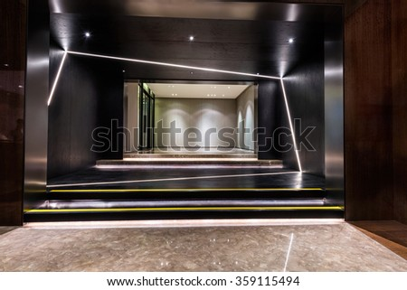 Illuminated and empty foyer entrance area of a building - stock photo