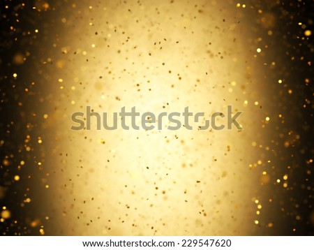 Illuminated background with gold confetti falling with depth of field. - stock photo