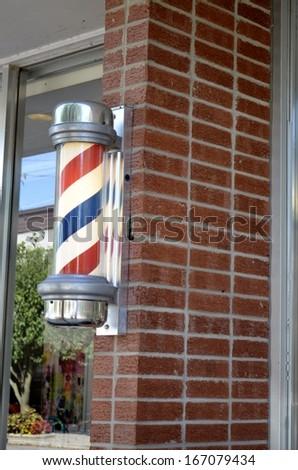 Illuminated Barber Shop Pole Sign - stock photo
