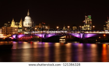 illuminated Blackfriars bridge in London at night - stock photo