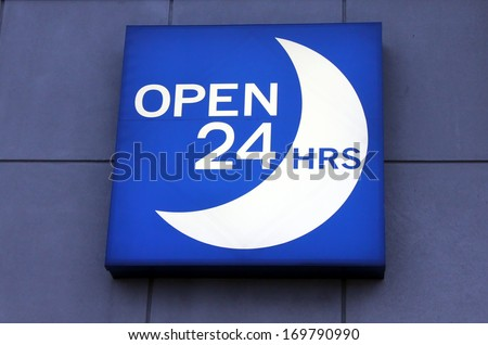 Illuminated blue open 24 hours sign - stock photo