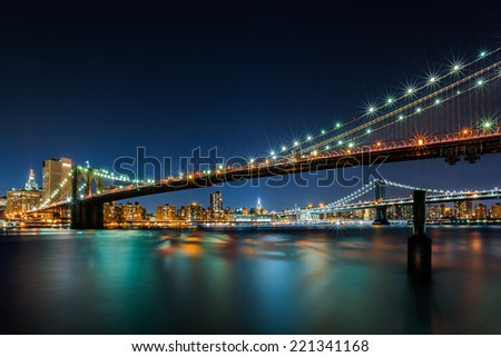 Illuminated Brooklyn Bridge ny night - stock photo