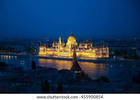 illuminated building of the National Hungarian Parliament at night aerial photo