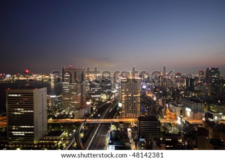 Illuminated buildings and roads of Tokyo during sunset - stock photo