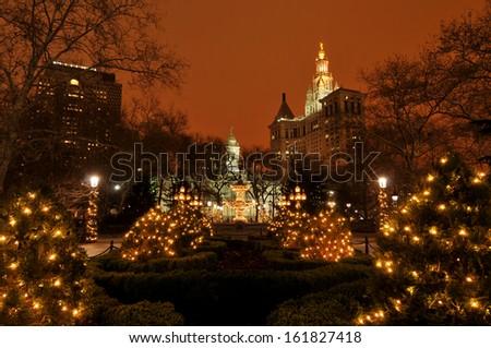 Illuminated buildings with decorative lights at night, Manhattan, New York, USA - stock photo
