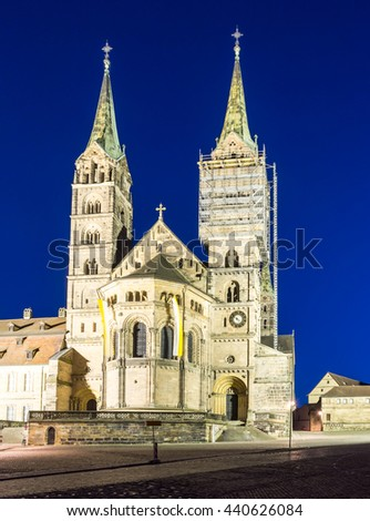 Illuminated cathedral of Bamberg at night - stock photo