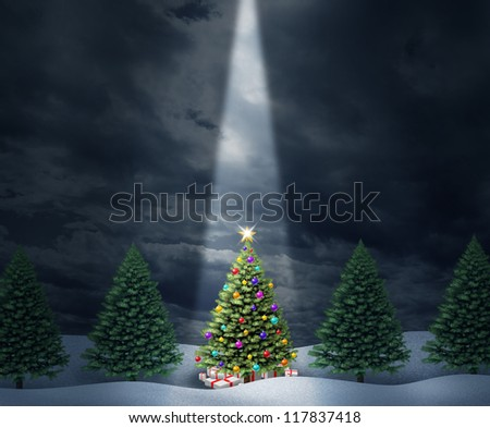Illuminated Christmas tree with a row of evergreen pines and a center decorated holiday icon with bows and gifts enlightened with heavenly light from above  against a cold peaceful winter night. - stock photo