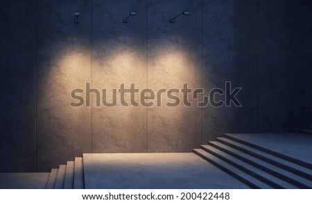 illuminated concrete wall and stairs at night - stock photo