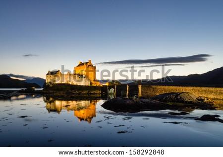 Illuminated Eilean Donan castle / Eilean Donan the iconic Scottish castle at dusk - stock photo