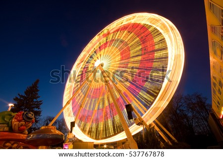 Illuminated ferris wheel in night