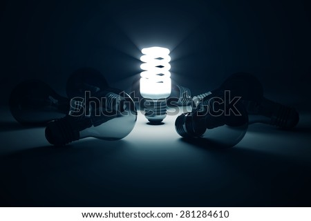 Illuminated Fluorescent Light Bulb standing out from the others Light Bulbs. Individuality Conceptual Background - stock photo