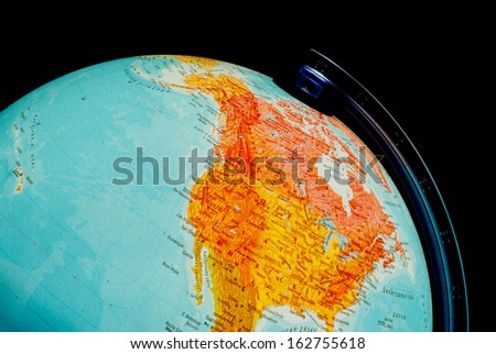 Illuminated globe close up. North America. - stock photo