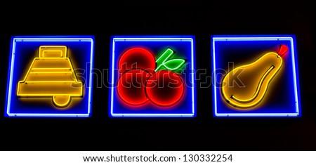 illuminated icons symbolizing slot machine options - stock photo