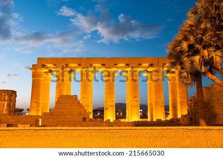Illuminated Luxor Temple. The Peristyle Court of Amenhotep III and Hypostyle Hall of Egypt. - stock photo