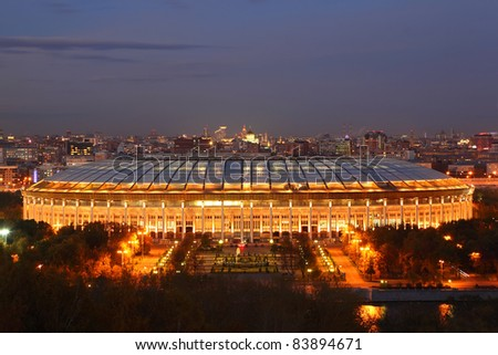 Illuminated Luzhniki Stadium at evening, panorama of Moscow from Vorobyovy Hills - stock photo