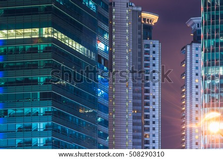 illuminated modern buildings at night in China.