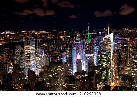 Illuminated New York skyscrapers by night - stock photo