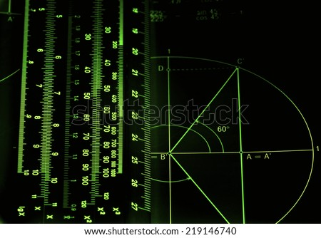 Illuminated numbers and graphic on dark background - stock photo