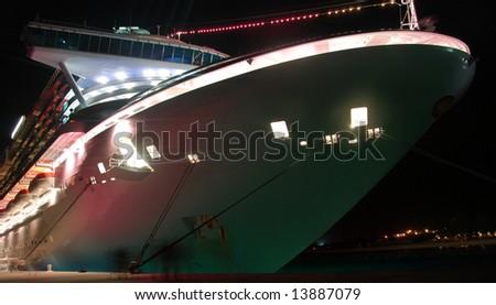 Illuminated ocean liner in port