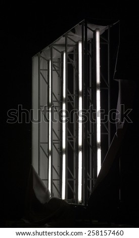 Illuminated panel ripped off showing the fluorescent tubes inside. - stock photo