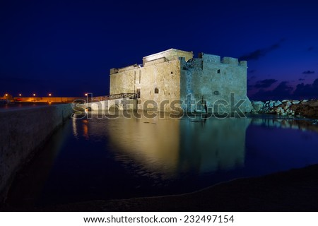 Illuminated Paphos Castle located in the city harbour at night with reflection in the water, Cyprus. - stock photo