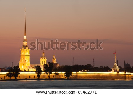 Illuminated Peter and Paul fortress at sunset, St Petersburg, Russia