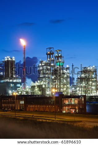 Illuminated petrochemical plant in twilight (Antwerp port, Belgium) - stock photo