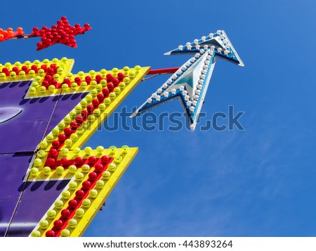 illuminated sign of star and pointer with shaped light against the blue sky with copy space - stock photo