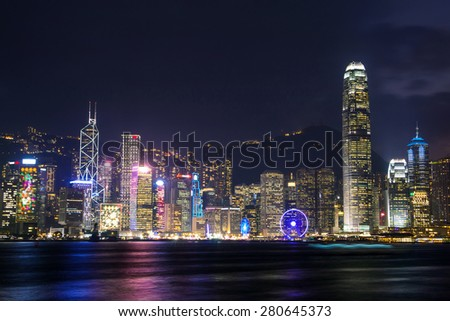 illuminated skyscrapers in victoria harbor,hongkong.