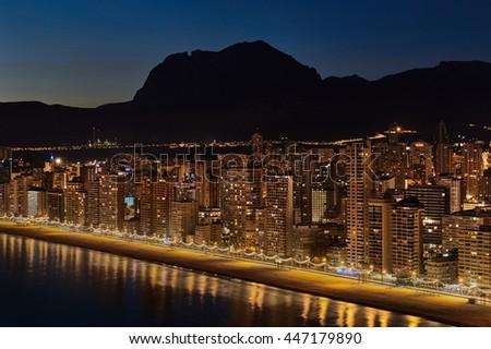 Illuminated skyscrapers of a Benidorm city at night. Costa Blanca, Alicante province. Spain  - stock photo