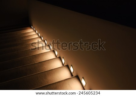 Illuminated stairs in the building. Suspense background. - stock photo