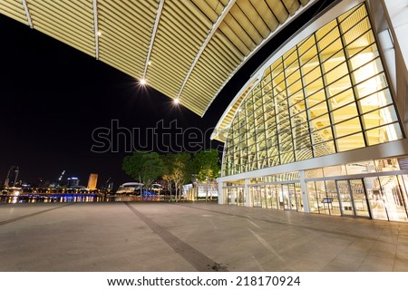illuminated urban building exterior - stock photo