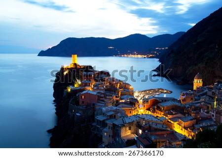 Illuminated Vernazza Village at Dusk, Cinque Terre, Italy - stock photo