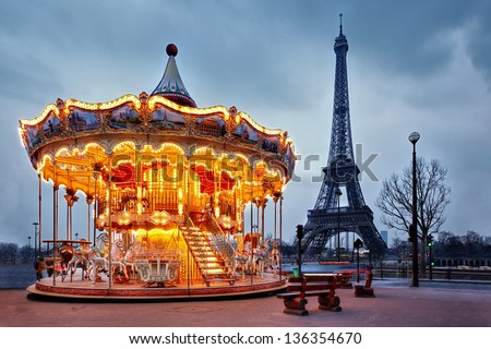 illuminated vintage carousel close to Eiffel Tower, Paris - stock photo