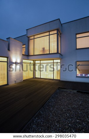 Illuminated windows in detached house - picture done at night