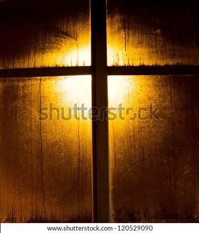 illuminated wooden window frame - faith symbol - stock photo