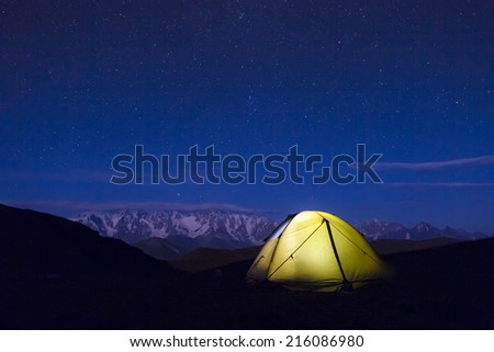 Illuminated Yellow Camping tent at Night  - stock photo