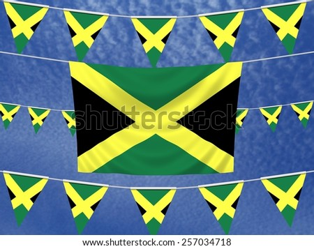 Illustrated flag of Jamaica with bunting and a sky background - stock photo