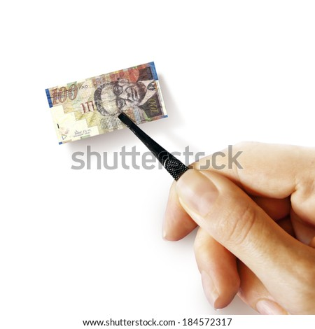 Illustration for inflation - hand with a pincer holding small banknote of Israeli shekel, white background